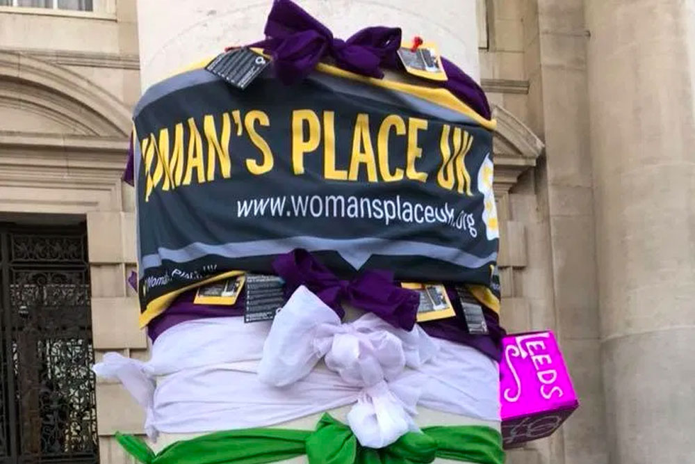 Woman's Place UK banner tied to a tree in protest ©WPUK
